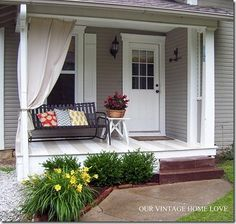 back porch with painted floor and drop cloth drape via Our Vintage Home Love