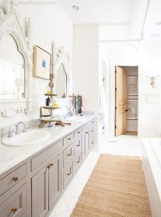 Lovely large bathroom with gray cabinets.