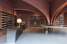 Twelve rose-tinged clay arches fan out over a huge stainless-steel sink in this Snøhetta-designed Aesop store, designed in tribute to Oscar Niemeyer.