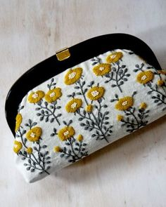 I should start embroidering my purses.. so cute!: