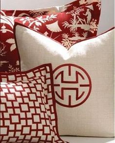 Custom-made red and white Asian-inspired decorative pillows from the Crystal Lake bedding collection by Legacy Home.