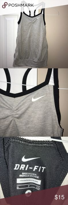 Girls Nike Dry Fit workout top size small Girls dry fit Nike top with built in bra.  Gray, black and white. Has banded bottom. Shirts & Tops Tank Tops