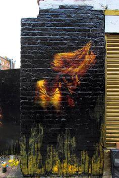 Street art in East London, UK, by Stamford-based street artist Snik. Photo by StreetArtNews.