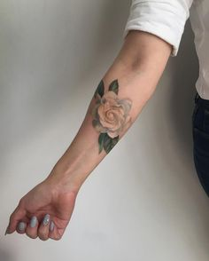 Forearm colored rose tattoo by amandawachob