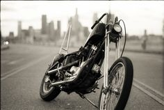 """I love these long springer forks, but not sure I could manage those handlebars.  Cool sissy bar and LOUD pipes.  """"Psychedelic '70s Sportster Chopper Pictures"""""""