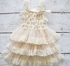 Lightweight ivory ruffle dress. Darling with cowgirl boots!