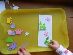 Match it Tray activity.  One side of the card is prepared, child has to find matching stickers and place on the other side of card, the same way.