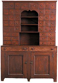 Early 19th-century New England step-back apothecary cupboard.