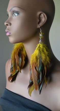Yellow iridescent feather earrings are made with yellow and black iridescent feathers and finished off with yellow crystal beads. Earrings are about 9 inches in length. Wing Earrings, Feather Earrings, Gemstone Earrings, Loc Jewelry, Wire Jewelry, Handmade Jewelry, Feather Art, Feather Jewelry, Yellow Feathers