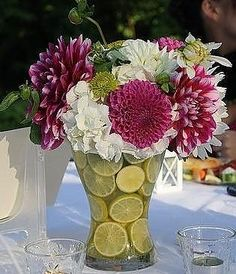 Inexpensive. Would look great with orange and yellow gerber daisies loritvargas