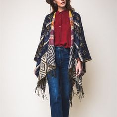 """""""Dreams"""" Navy Blue Poncho Wrap Shrug Navy blue printed poncho wrap cardigan. Best selling poncho wrap cardigan. 100% acrylic. Also available in brown. Brand new in packaging. One size fits most. 61"""" x 55"""". Bare Anthology Sweaters Shrugs & Ponchos"""