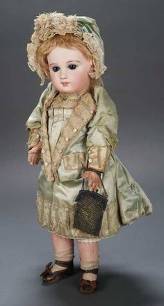 French Bisque Bebe with Incised Depose Mark and Couturier Costume by Jumeau and Signed Jumeau Shoes, 51 cm, ,circa 1884.