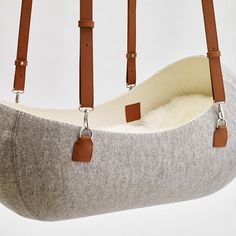 Check this out: A Hanging Felt Cradle Inspired by the Womb. https://re.dwnld.me/3w56p-a-hanging-felt-cradle-inspired-by-the-womb