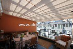 Porches acristalados con techos y cortinas de cristal