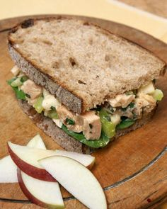 Martha's Favorite Tuna Salad Sandwich - Martha loves moist, oil-packed tuna mixed with celery, apple, fresh basil, light mayo, and a squeeze of lemon juice. Make sandwiches on good-quality sourdough bread for a delicious and nutritious picnic lunch.