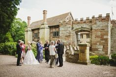 mingling outside the moated medieval manor house of Birtsmorton Court