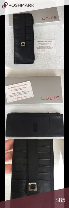 NWB LODIS BLACK LEATHER Ladies wallet Gorgeous leather travel and every day wallet with top zip and 8 credit card slip pockets. Comes with box and tissue. I was given this gorgeous wallet as a gift and never used it. Smoke free closet. No defects. It has RFID protection. Lodis Accessories Key & Card Holders