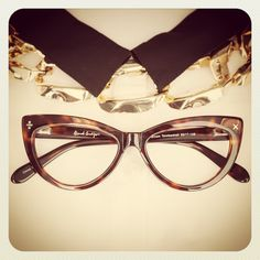 Derek Cardigan meets cat eye. Classy, elegant with a touch of geek chic.