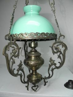 Victorian embossed and pierced gilt brass electrified hanging lamp. Original green glass shade, with three hanging ch. Victorian Gothic Decor, Victorian Lighting, Victorian Lamps, Antique Lighting, Victorian Rooms, Antique Oil Lamps, Antique Chandelier, Vintage Lamps, Chandeliers
