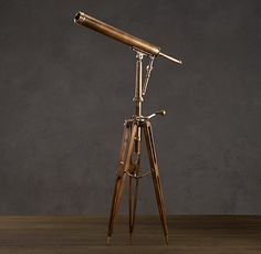19th C. Parisian Brass Telescope |  Reproduced from a 19th-century original by a Parisian manufacturer of telescopes, microscopes and lenses, this telescope is a perfect blend of technology and historical design. Resting on the vintage-inspired tripod base is a powerful lens with 12x magnification and an antiqued finish that recalls the original. ($2995)