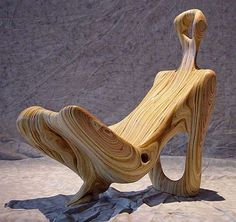 Anthropomorphic chair designed by Sergio Gill. It resembles a reclining female figure. Gill used a software program that scanned the female body, then translated it into another stylizing software program called AlphaCAM. Finally, Gill used a birch plywood model with a tung oil furniture finish.