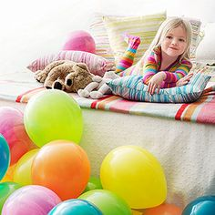 I am so starting this tradition this year!!!!   On their birthday, cover the floor of their room with balloons while they sleep. That way they have a big surprise when they wake up.