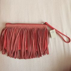 American Eagle Coral wristlet! This has never been used and is in perfect condition! American Eagle Outfitters Bags Clutches & Wristlets