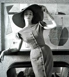 Dorian Leigh in a figure-hugging dress by Jacques Fath <3 March 1954