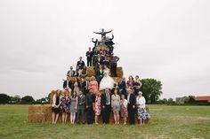 Using bales of hay for group shots. Hay stack group photos. Hay stacks at weddings.