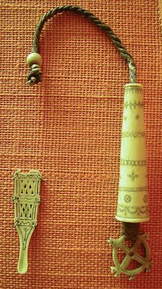 Saami needle case and ear spoon