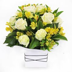 Zesty - roses and peruvian lilies in a clean white box.