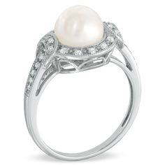 Freshwater pearl & diamond ring.  (Kids birthstones.  Wish it were white gold or platinum for strength.)