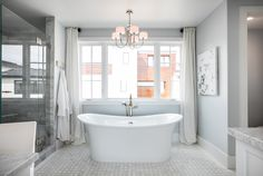 Chapter 16 - Park Place is all about timeless beauty, elegance and glamour. The floors are tiled with Terrace on the Park mosaics in grey. Photo courtesy of Berk Custom Homes