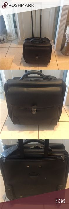 """Leather Laptop Case w/ wheels This case is awesome. So many compartments. Has a hand strap as well. Great condition. Measures 15.5""""X13.5"""". Great deal Avenues America Bags Laptop Bags"""