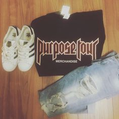 Purpose Tour shirt, ripped jeans, black and white adidas sneakers