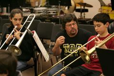 Mic Gillette former horn player with Tower of Power, works with trombone players, Maya Schechter, 7th grader, left, and Michael Leamy, 6th grader. He is assisting in the music department at Stanley Middle School in Lafayette.  Photo: Deanne Fitzmaurice, SFC