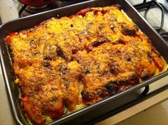 Baked zucchini, potatoes and peppers, with herb cheese and onions, au gratin with Parmigiano Reggiano.