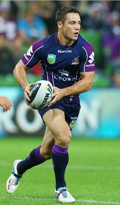 Cooper Cronk of the Storm looks ahead with the ball during the round 5 NRL match between the Melbourne Storm and the Wests Tigers at AAMI Stadium on April 8, 2013 in Melbourne, Australia.