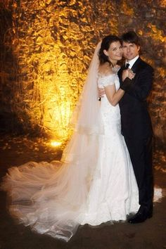 Katie Holmes wore an off-the-shoulder gown by Giorgio Armani for her November 2006 wedding to Tom Cruise in Italy.