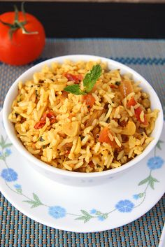 Tomato Rice - A wonderful rice dish from the South Indian Cuisine perfect to pack for your lunchbox. If anyone is starting to learn cooking or bachelors looking for recipes to try, this is probably one of the recipes to start with.