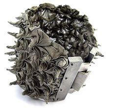 Pawel Kaczynski  Bracelet: Spiral 2005  Silver, steel  Steel mesh fabric as textile