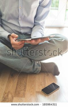 close up hands multitasking man using tablet connecting wifi - stock photo BUY IT FROM $1 ON SHUTTERSTOCK