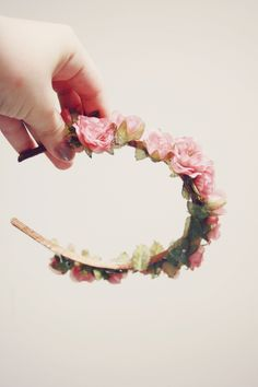 Floral hairband. Much more practical then a crown.