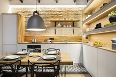 """Architecture and design studio Egue y Seta designed this small and compact beach house in Barcelona, Spain. The project was completed in """"Whether you like it or not, Barcelona, for many non-l… Small Rustic Kitchens, Rustic Kitchen Design, Contemporary Kitchen Design, Contemporary Homes, Space Saving Kitchen, Small Space Kitchen, Small Spaces, Kitchen And Bath, Kitchen Dining"""
