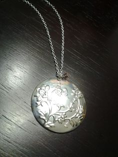 Silver flower plated disc pendant by UniqueAntiqueJewels, $15.00
