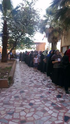 For the first time in 40 years after Ghadafi. The Libyan people got to vote. Huge turn out at a school in Tripoli. 40 Years, First Time, School, People, People Illustration