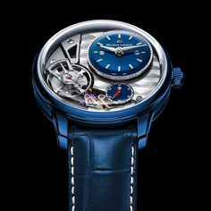 "Maurice Lacroix Masterpiece Gravity  For Only Watch 2015 Maurice Lacroix has created the cutting-edge Masterpiece Gravity ""Only Watch 2015"". Its blue polished POWERLITE case is a special design creating an eye-catching effect. Using a unique andpatented alloy Maurice Lacroix fused Titanium Aluminum Magnesium Zirconium and Ceramic to form a robust durable and light alloy. Matching bluelacquered time andseconds dialscompletethe look with rhodied logo indexes hour and minute hands and a red…"