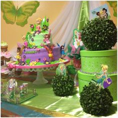 What a pretty table at a Tinkerbell party!  See more party ideas at CatchMyParty.com!  #girlbirthday #fairy #partyideas