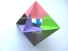 Modular Spinner  This origami combines both the basic waterbomb and square bases to form a modular unit. You then assemble six of the units without using glue to form a sturdy modular spinner. The finished origami looks really unique as the center is hollow.