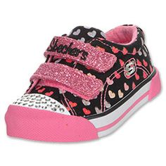 Dip into glitzy fun style with the SKECHERS Twinkle Toes shoe. Soft denim fabric upper in a slip on casual sneaker with Rhinestone front, colorful tattoo designs and stretch front panel.
